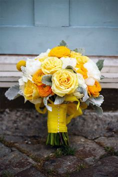 Yellow roses, orange and white ranunculus.