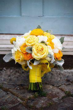 Yellow roses, orange and white ranunculus.