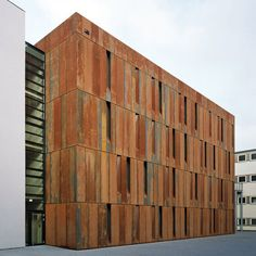 Following our recent feature about buildings clad in weathered steel, here's an archive in Essen, Germany, that is clad in Corten. Designed by German studio Scheidt Kasprusch Architekten, the four-storey building contains a public archive for the city's historical records and documents. The steel panels create stripes across the facade, interrupted by angled recesses concealing narrow