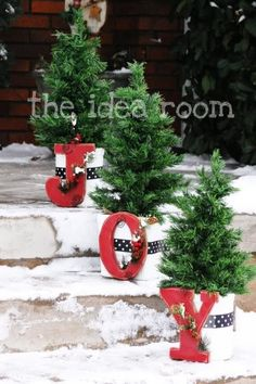 "Front Porch Decor planters with little trees and Bright Red ""JOY"" letters attached to planters with burlap!"