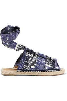 Chloé's canvas espadrilles are decorated with a bandana-inspired print in tonal-blue and off-white shades. This pair is finished with a cool knotted front and a leather-trimmed sole reinforced at the base with rubber. Adjust the ankle ties for a customized fit.