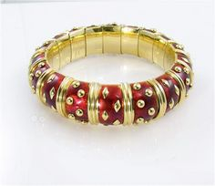 An 18 karat yellow gold and burgundy enamel bangle. Schlumberger Tiffany & Co. circa 1990's- Camilla Dietz Bergeron