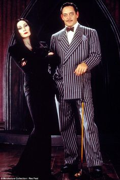 Original: Morticia and Gomez Addams famously played by Raúl Juliá and Anjelica Huston - couples costume possibility