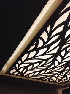 Laser cut suspended light feature. St Pierre Hotel and Spa - Guernsey. Frond design by Miles and Lincoln. www.milesandlincoln.com