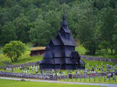 """This is the Borgund stave church, in the west-central Norwegian county of Sogn og Fjordane. It is a medieval wooden church built sometime between 1180 and 1250 AD, with later additions and restorations. Its walls are formed by vertical wooden boards, or staves, hence the name """"stave church"""". This is one of the best preserved of Norway's 28 remaining stave churches."""