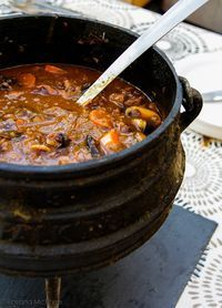 Oxtail and red wine potjie. This traditional South African stew of oxtails and red wine is cooked outdoors in a cast-iron pot over coals - perfect campfire food Oxtail Recipes, Meat Recipes, Cooking Recipes, Recipies, Oven Recipes, Juicer Recipes, Dishes Recipes, Cooking Food, Curry Recipes