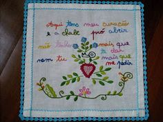 """Traditional Portuguese courtship handkerchief. The rime goes:     """"Here you have my heart,/ and the key to open it. / I don't have anything else to give, / and you should not have anything else to ask""""."""