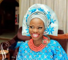 silver and blue gele and lace attire