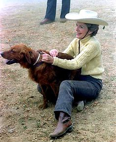 Nancy Reagan with her dog Victory, a golden retriever, in 1981