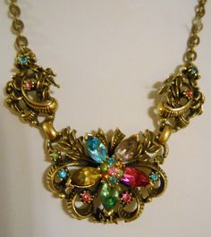 Rare Early CORO Art Nouveau Bronze Plated Necklace with Faceted Marquise & Round Austrian Crystals Austrian Crystal, Flower Pendant, Vintage Jewelry, Vintage Necklaces, Vintage Rhinestone, Peridot, Etsy Vintage, Art Nouveau, 1950s