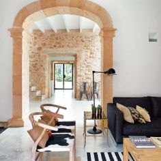 Beautifully restored oil mill in Mallorca, Spain combines vintage, industrial and modern touches.