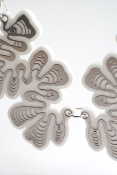 Ammonite Necklace.  stainless steel and white acrylic by Nervous System