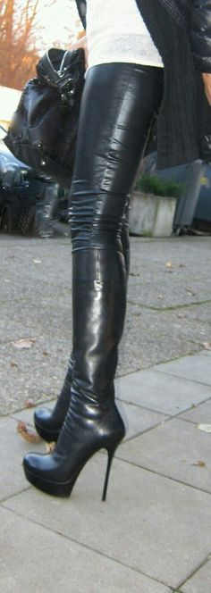 Candid street style amateur in black leather pants and black leather platform thigh boots