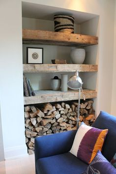 reclaimed wood shelves next to fireplace - Google Search