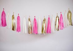 Lets celebrate with this Fuchsia, Ivory, Gold tassel garland!  This tassel garland is great for: weddings bridal showers birthday parties baby showers gender reveal home decor nursery or childrens room dorm decor photo backdrop and much more!  This tassel garland is handmade with love using tissue paper. The garland comes ready to hang at 8 feet long when tassels are spread apart evenly. Tassels can be easily moved along the twine to provide a sparser or fuller look depending on your taste…