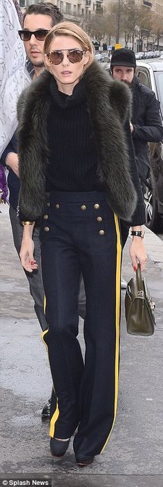Stylish: She tipped her nose with stylish sunglasses from her own range...