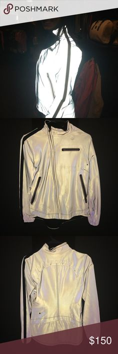 Fully reflective Lululemon jacket AWESOME! Fully reflective lululemon jacket, size 8. Retails $289, material is iLuminate. Rare piece from lululemon and great for night running. Great for visibility and safety!!! This jacket is in great condition, but the fabric is very sensitive and shows wrinkles or water very easily. (Until hand washed in cold) lululemon athletica Jackets & Coats
