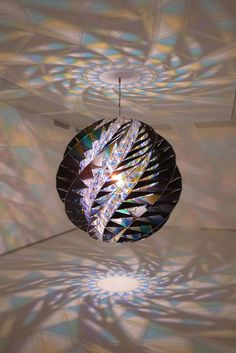 Kaleidoscopic Light Sculptures Fill The Room With Hypnotizing Color Patterns