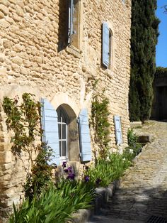 Cobblestone and blue shutters in Provence - beauty in its simplicity