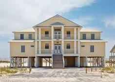 Gulf Shores, AL: This beachfront home is nestled among the sugar white sands of Gulf Shores, Alabama. This 2-level, 6-bedroom, 7-bathroom home is spacious and has 2 Gu...