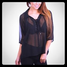 Black Lace-Up Top This sheer, collared 3/4 sleeve top has a semi hi-low hem and a partial lace-up front. Super sexy! Tops Blouses