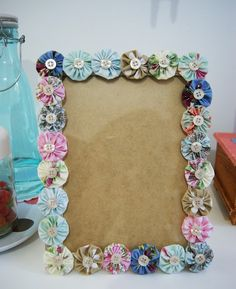 Frame decorated with fabric yo-yos and buttons