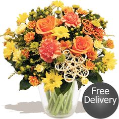 Falling Leaves  An beautiful autumn bouquet, handmade by our expert florists using bright orange Roses, saffron yellow Solidago flower, orange Carnations & Spray Carnations with trendy lime green Santini flower, fresh Chrysanthemums, plump Hypericum berries and finished with wicker flower decorations. A popular autumnal choice that's sure to delight. Fresh Flowers, Beautiful Flowers, Carnations, Chrysanthemums, Flower Decorations, Table Decorations, Fall Bouquets, Flowers Delivered, Orange Roses
