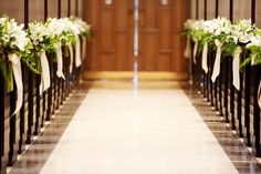 Beautiful flower details added to church pews #aisledecor #theweddingbelle #love - For more ideas and inspiration like this, check out our website at www.theweddingbele.net
