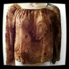 Beautiful Fall Design Women's Top It's sheer and a light chocolate and dark chocolate design. The sleeves are fanned and it can be worn normal or off the shoulder. Eye Candy  Tops Blouses