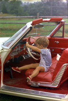 John F. Kennedy, Jr. - A great, candid shot of John-John playing inside a 1960s' convertible.
