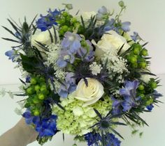 Blue, white & green bridal bouquets are very popular! This one with queen annes lace, green hydrangea, delphinium, roses and more!