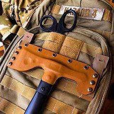 SOG FastHawk Sheath, I don't have a exact need for this but I still want it badly :)
