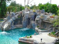 The natural boulder waterfall of this lagoon-style pool definitely attracts  attention. The pool also features a spacious grotto, custom