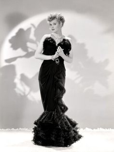 1940's Publicity Still of Lucille Ball modeling a lovely black gown.  -  allposters.com