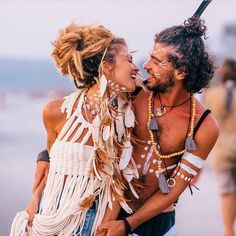 """Sometimes you get lucky and you find a soul that grooves with yours"" These 2 always spreading so much love. Most beautiful gypsy couple out there. @alisa.belochkina and her @mockni head feather pieces. Top by @fancinasalvaje"