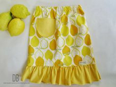 FREE Pattern and Tutorial from Daydream Believers: The Lemonade Stand Skirt. Sizes 2t -8! Tips for gathering, making ruffles, and creating a sweet little pocket! www.daydreambelieversdesigns.com