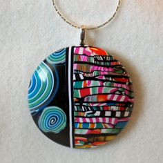 Teal Swirl and Multicolor Stripe Domed Pendant Necklace FREE SHIPPING. $26.99, via Etsy.