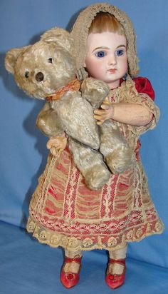 A stunningly beautiful Early Depose French Jumeau Bébé Bisque Doll from France. Marvelous petite cabinet size - Only 14 1/2 tall. The early French