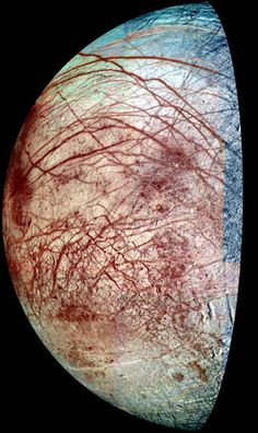 Europa, a moon of Jupiter, appears as a thick crescent in this enhanced-color image from NASA's Galileo spacecraft, which has been orbiting Jupiter since 1995. The view combines images taken in violet, green and near-infrared filters in 1998 and 1995. The colors have been stretched to show the subtle differences in materials that cover the icy surface of Europa.
