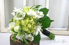 Garden inspired with green hydrangea, white scabiosa, lisianthus, orchids & freesia. Flowers by A Floral Affair #pdxweddings #weddingbouquet