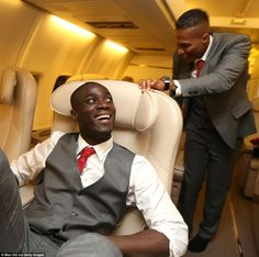 Eric Bailly looks up and sees Antonio Valencia, United's captain for the night, heading to his seat on the plane