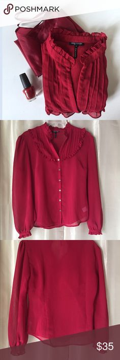 "OLEG CASSINI WINE RED BLOUSE & CAMISOLE Beautiful 2 pc set from Oleg Cassini in wine red. Long sleeve sheer blouse with half button front, open ruffled bib design at the neck & a single button closure at the ruffled cuffs. The matching camisole provides coverage & adds another layer to the sheer top offering a somewhat illusion look. The blouse is labeled size S Measures 38""-40"" bust, 32"" waist flaring to 38"". 100% polyester. I like this with the black silk Cassini pencil skirt. You can…"