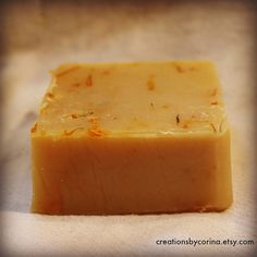 This luxurious soap was handmade in a small batch, with fresh, creamy goat milk from my beautiful goats, who are raised naturally and without chemicals. The soap also includes coconut oil, olive oil, palm oil, and pure essential oils of peppermint and rosemary. I infused the olive oil with my own organically grown calendula oil, which gives the soap amazing skin healing properties. I also added dried calendula flower petals, which add a lovey touch to this artisan soap.  This soap is…
