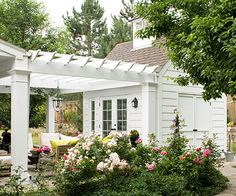 Transform our garage: add some patio doors, an arbor, gravel patio ground, sitting area and lots of roses and flowers!! Voila a romantic area!