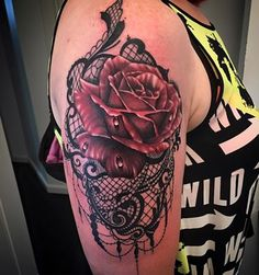 Realistic rose and lace shoulder piece by Lou shaw. For more of Lous work follow his Instagram and Facebook @Lou shaw tattoo