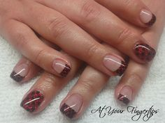 Red glitter with black polka dots gel nails