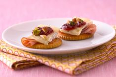 Use holiday leftovers to make these Raspberry-Brie RITZ Toppers! Ham, brie cheese, and raspberry preserves are a great snack combination for the next day.