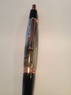 Stamps cast on a click pen in copper finish