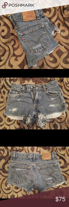 Vintage distressed Levi cut off shorts Vintage 550 distressed Levi cut off shorts ➵ Size 0 ➵ Vintage & slightly distressed ➵ High waisted ➵ Excellent condition & super cute ➵ Vintage Levi's are no longer made Levi's Shorts Jean Shorts