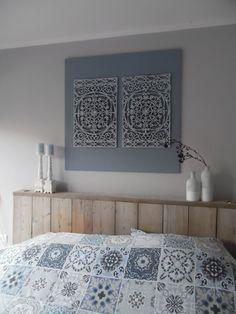 Een kunstwerk gemaakt van 2 rubberen deurmatten